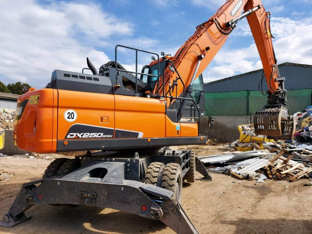 doosan material handler on waste recycling site in Peterborough