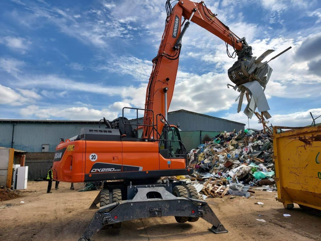 Doosan DX250WMH handling waste on recycling application in Peterborough